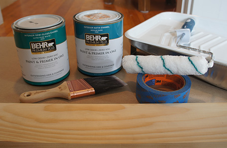 Paint roller and tray, paint brush, tape, lumber and two quarts of Behr paint