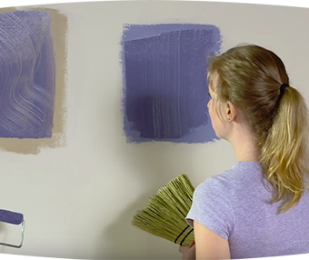 Woman staring at patches of paint on the wall