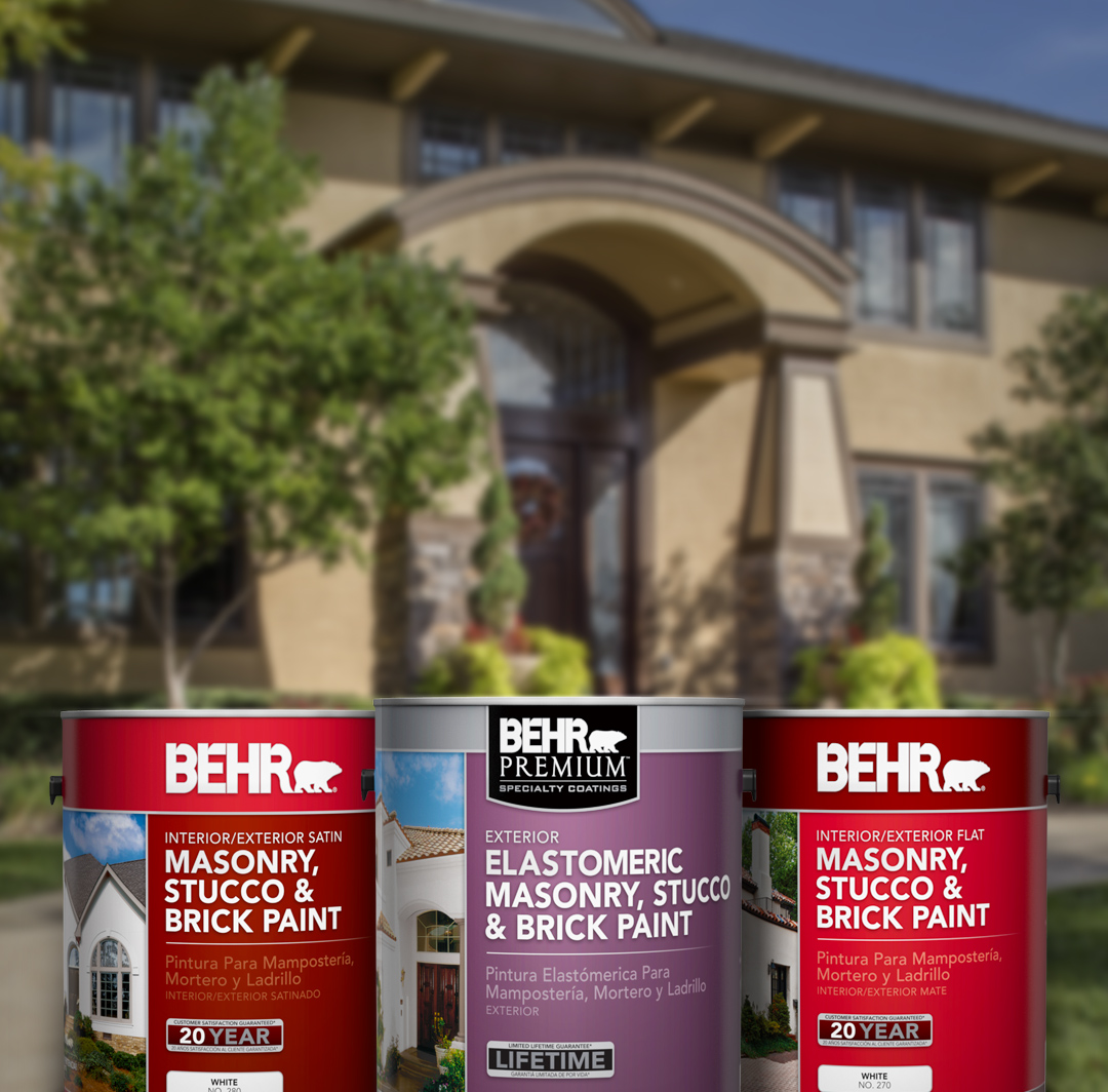 Three cans of Behr paint with large home and trees in the background, small image.